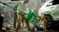"""Director Michael Bay demonstrates for Nicola Peltz how the """"hand"""" of a Transformer will attempt to snatch and capture her as she tries to flee from its grasp."""