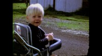 KC--1_-BABY_Stroller_Cobain-age-2-smiles-for-camera-in-still-from-never-before-seen-home-movies-featured-in-KURT-COBAIN-MONTAGE-OF-HECK